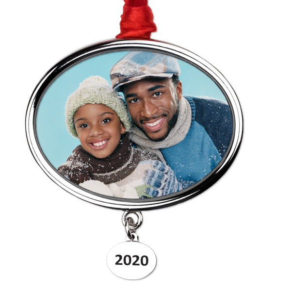 Create a beautiful silver ornament with the current year etched on a dangling pendant