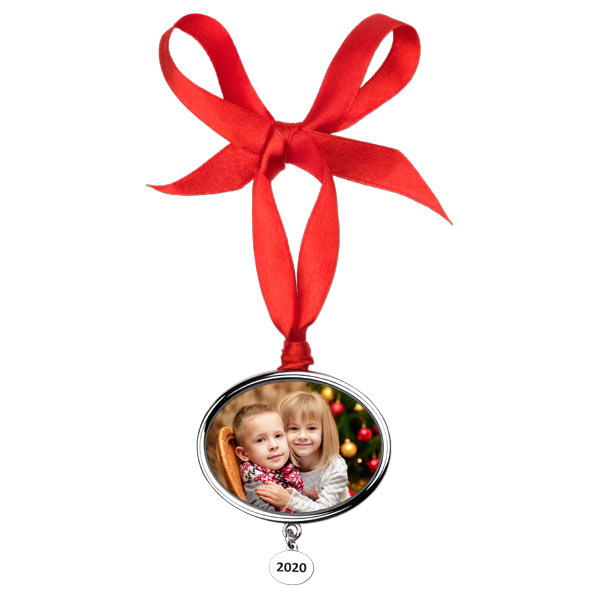 Create a designer oval ornament with etched year pendant hanging below the photo